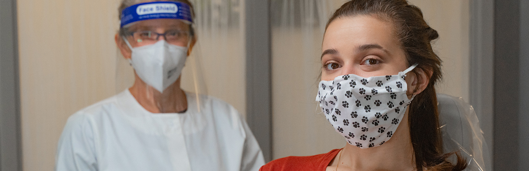 orthodontist with face shield mask